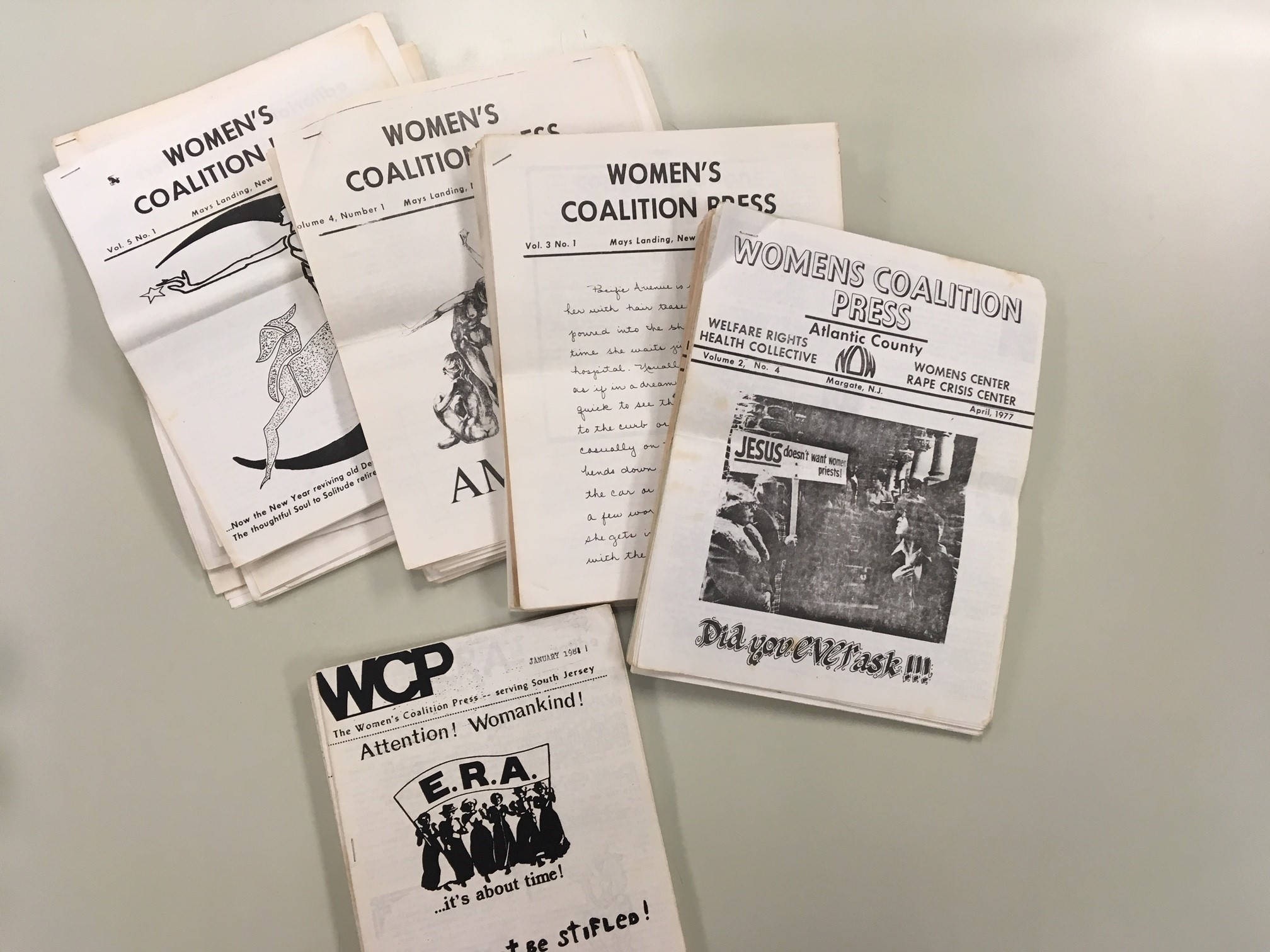 Image of copies of newsletter, Women's Coalition Press, on a table.