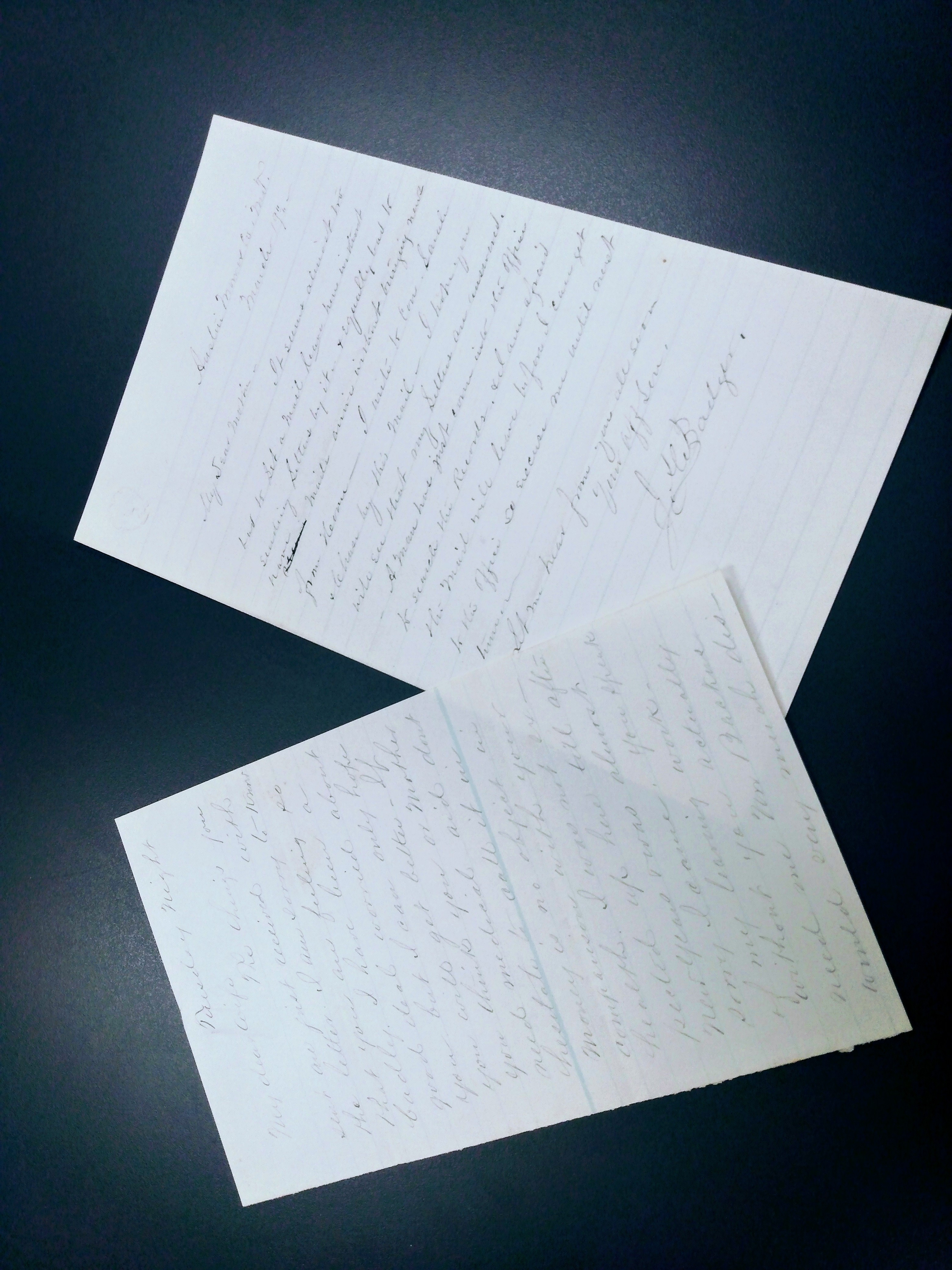 handwritten pages on a dark background
