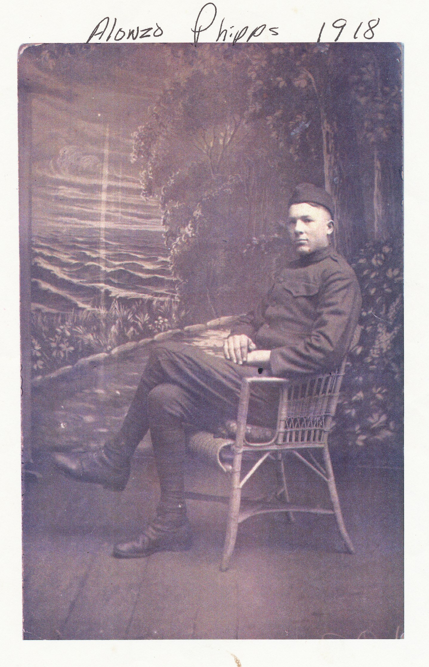 black and white portrait of manin uniform sitting in a chair