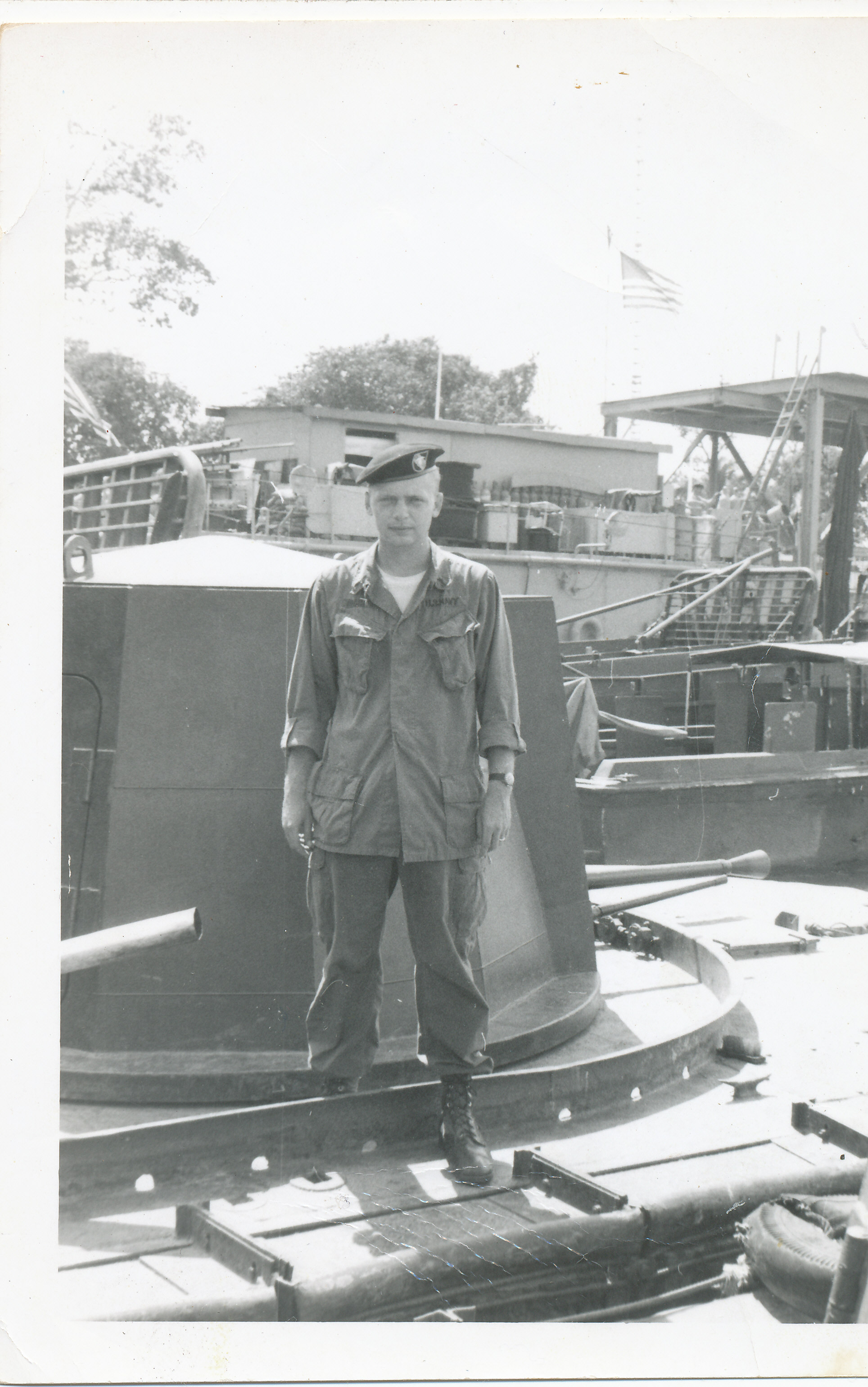 Artie standing on a ship