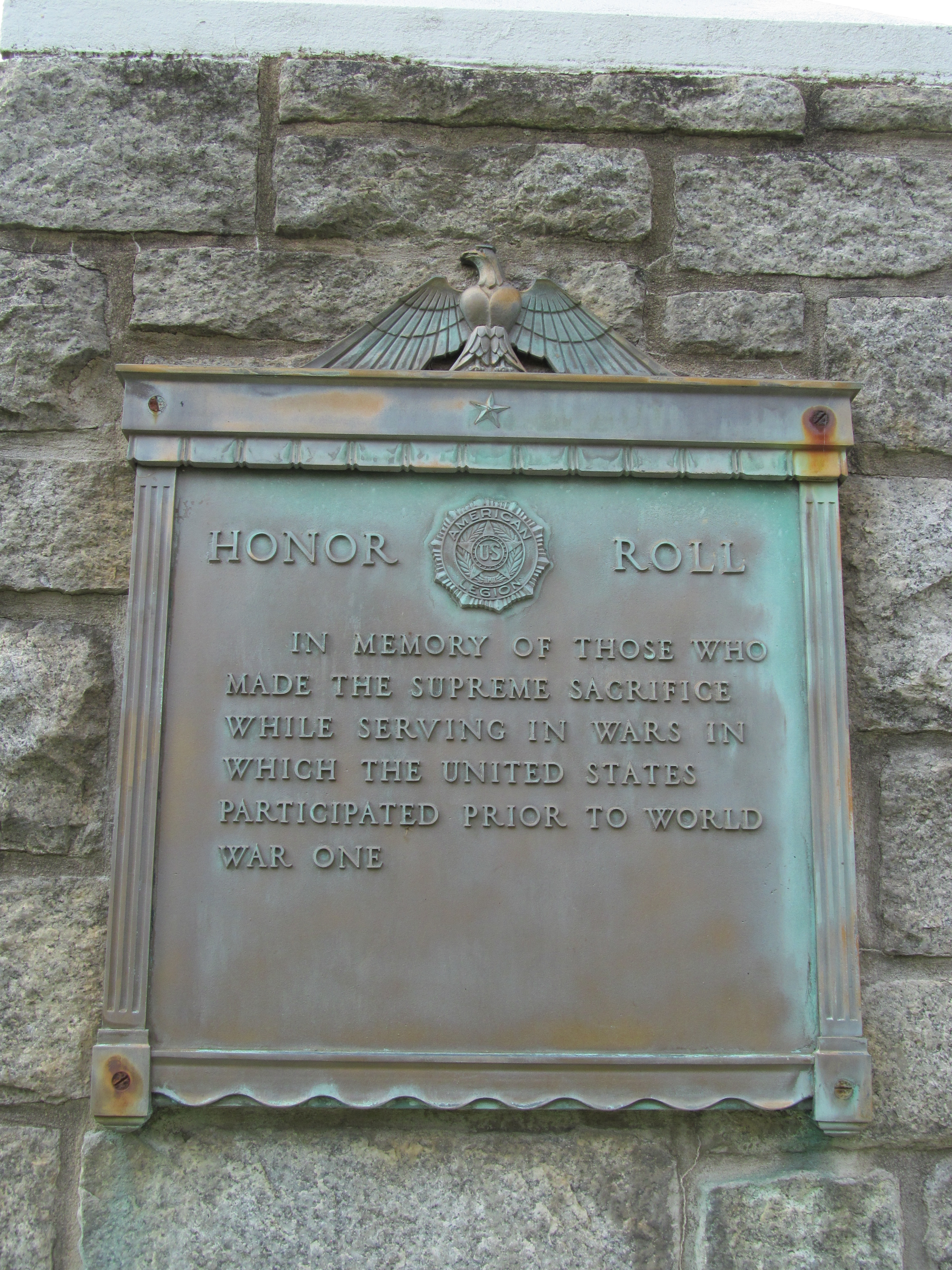 detail of plaque honoring veterans of prior wars
