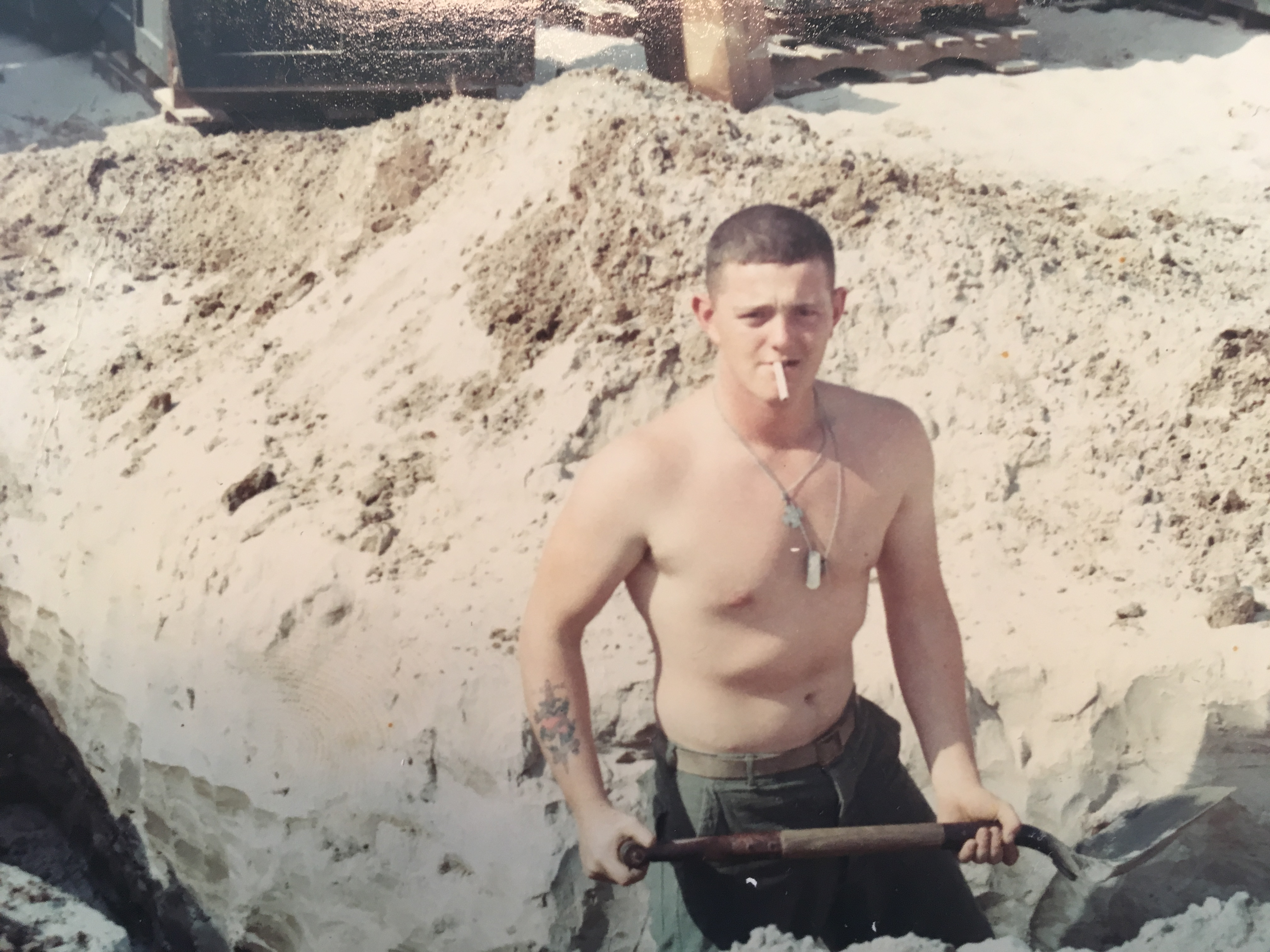 Bernie shovling sand in Vietnam