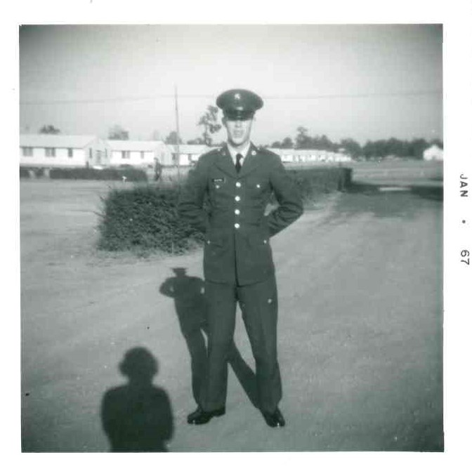 black and white photo of young man in dress uniform