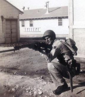 Eller at boot camp posing with a gun