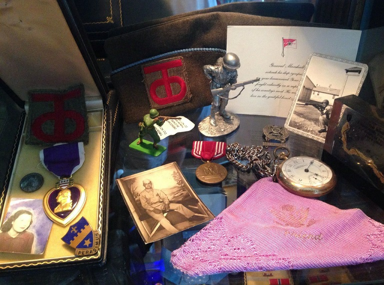 Assortment of medals and old photos
