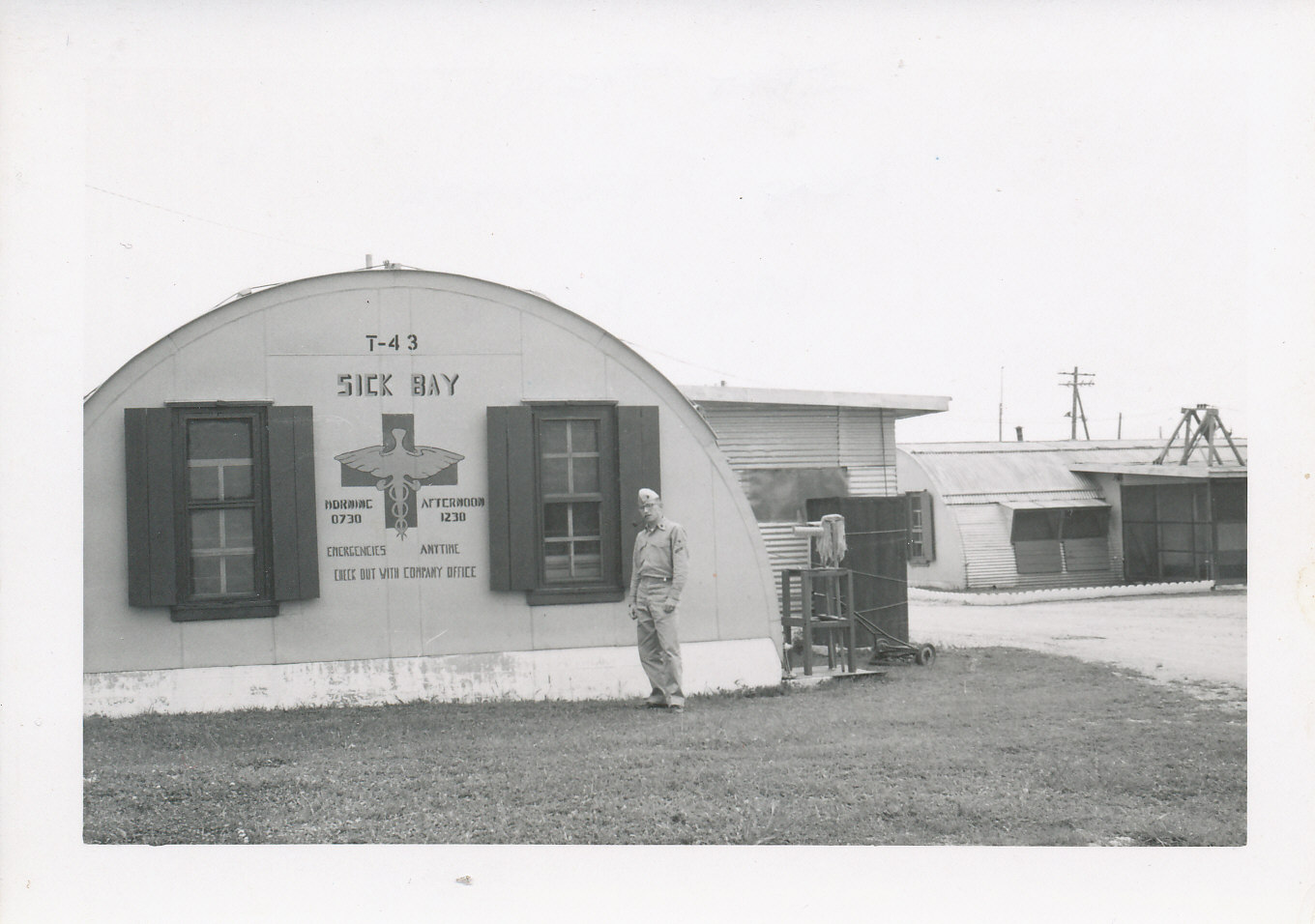 young man standing in front of sick bay