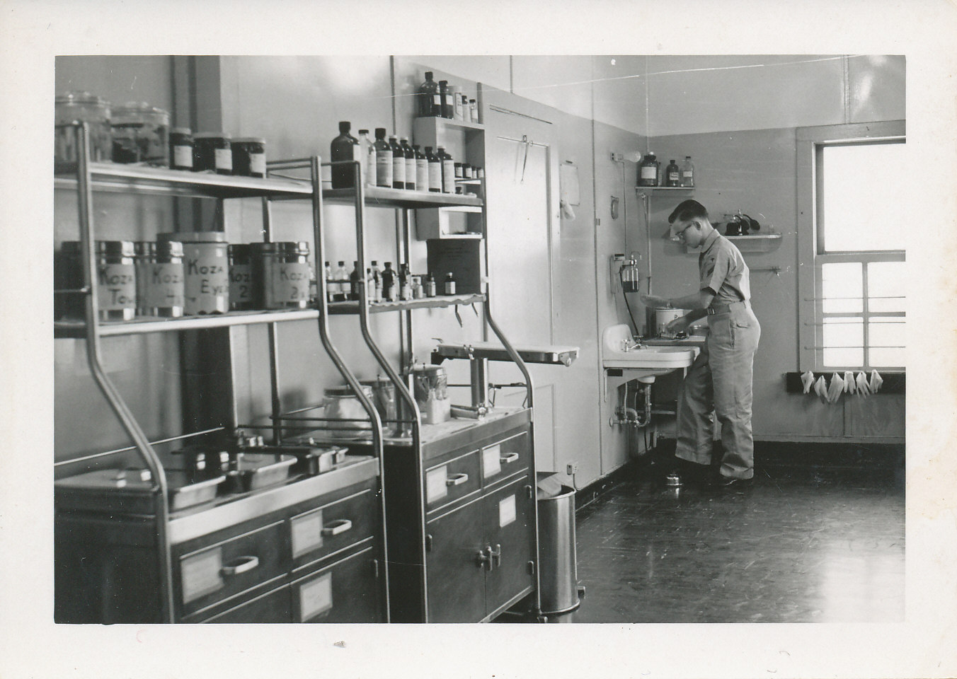 black and white photo of young man in medical ward