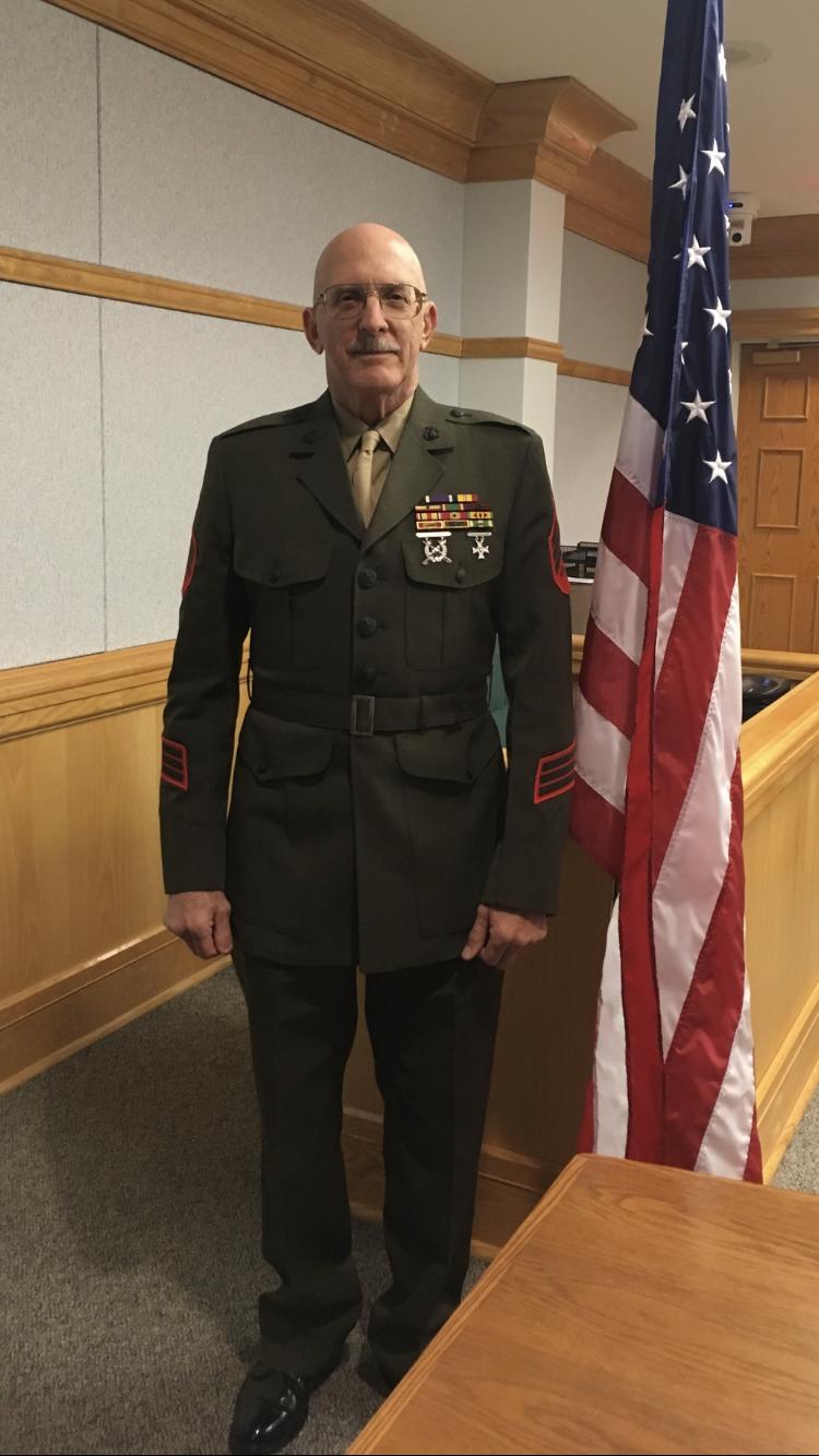 older man standing in military uniform