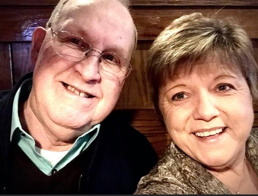 close-up photo of an older man and woman smiling
