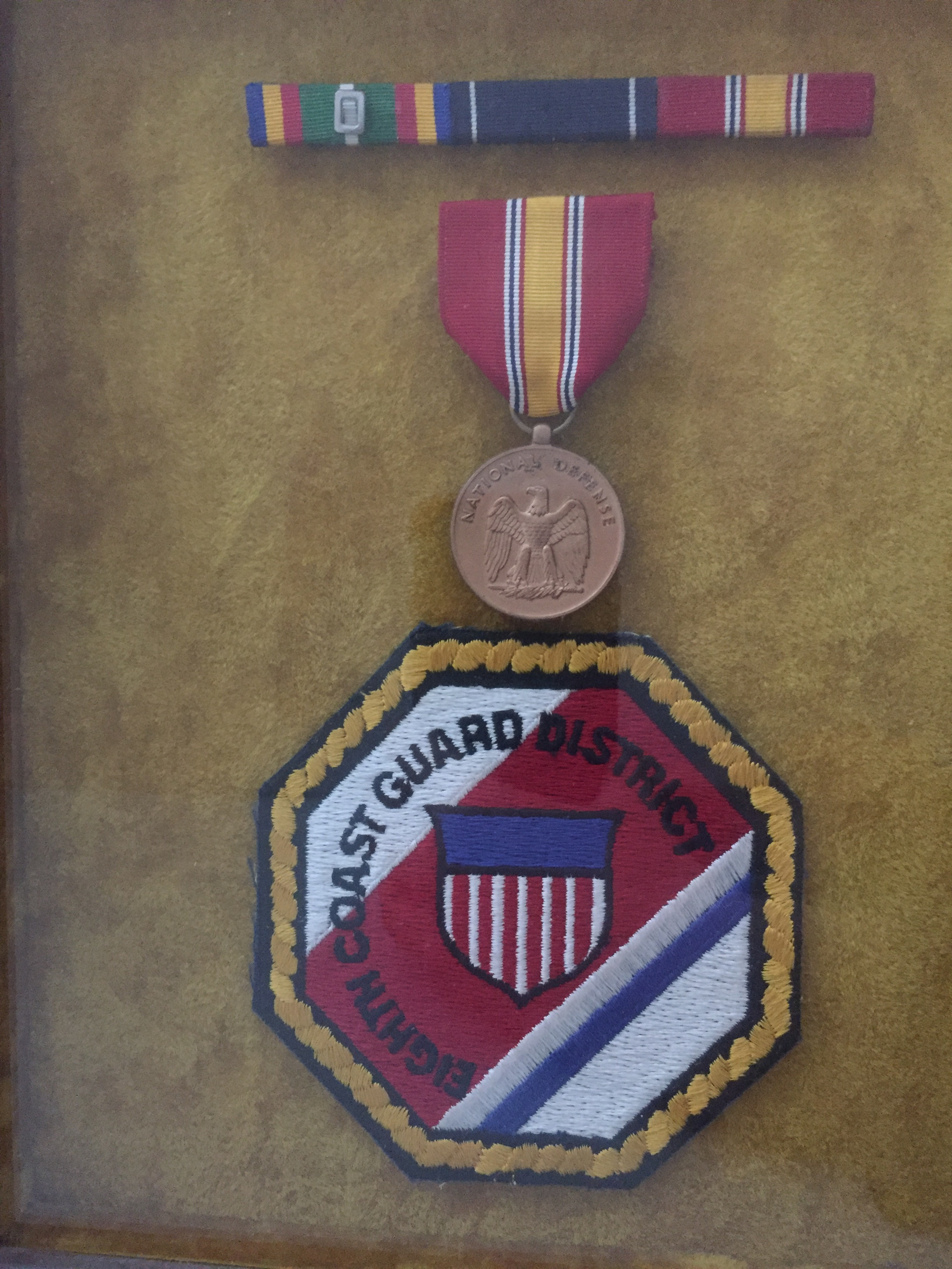 Shadow box containing medals and patches