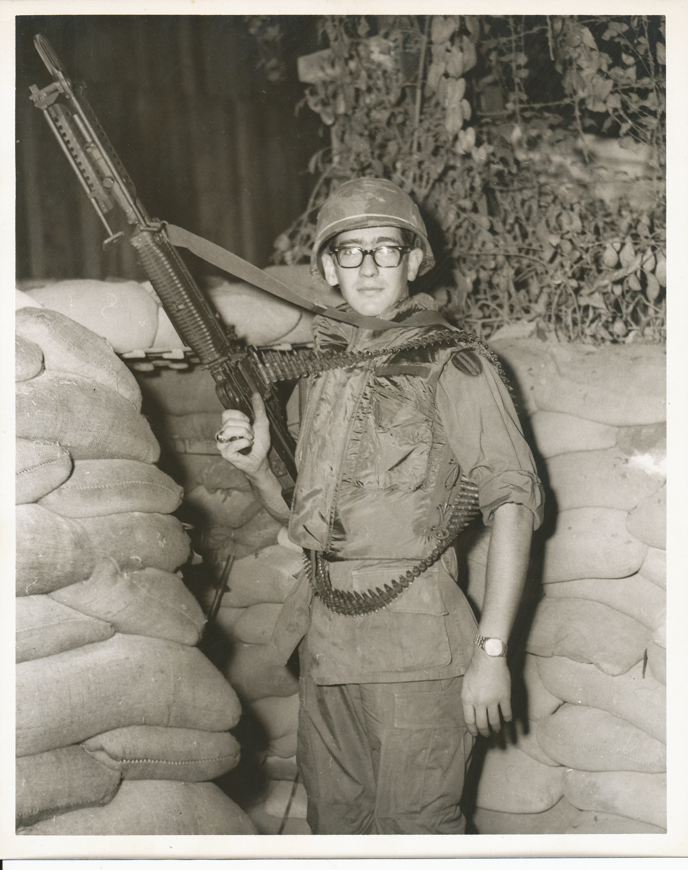 Black and white photo of soldier in uniform holding a gun