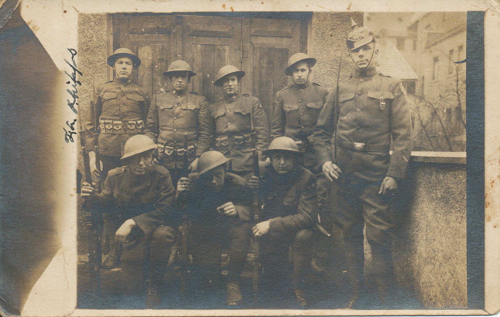 black and white photo of a group of soldiers standing in a doorway