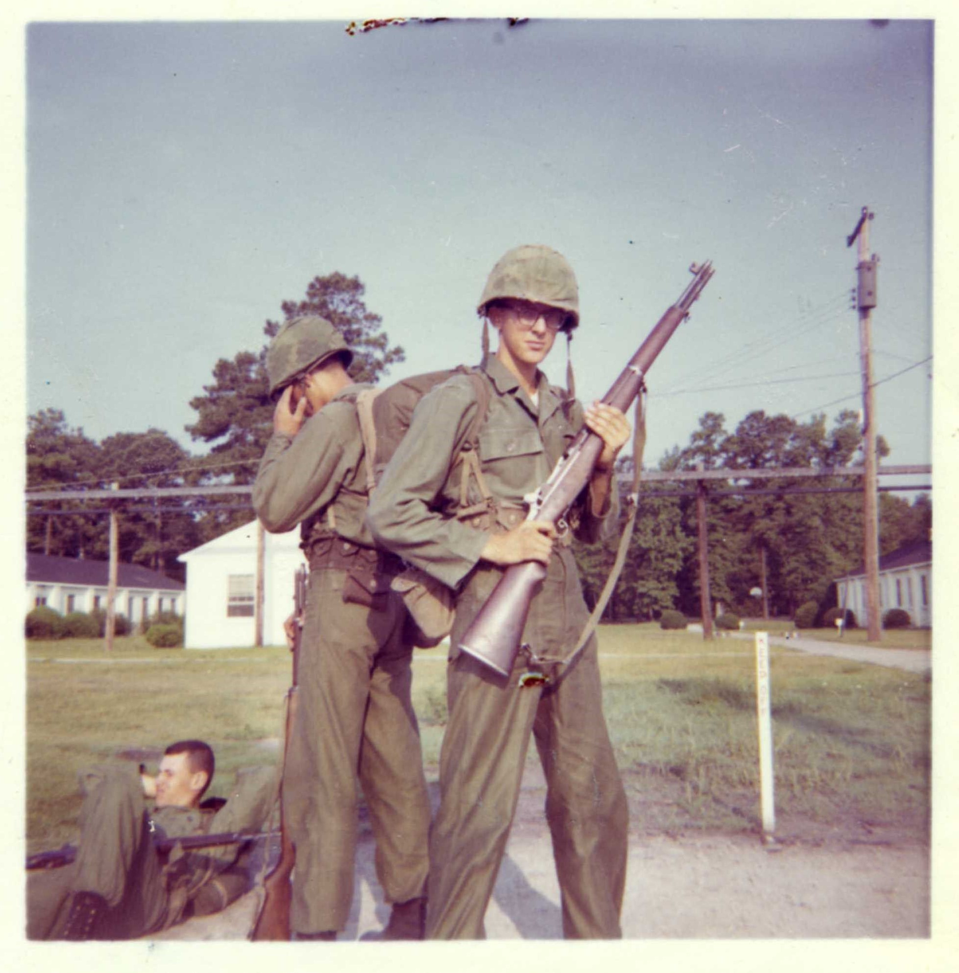 young soldiers posing with guns