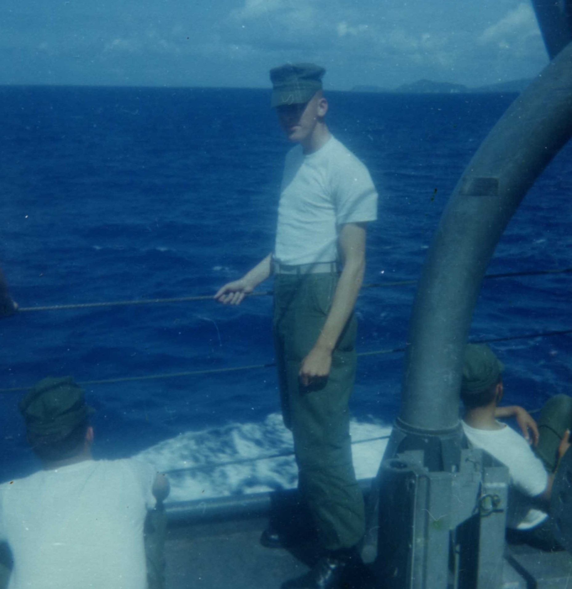 soldier in white teeshirt at the back of a boat
