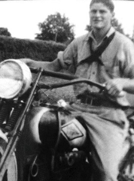 Black and white photo of Eller on a motorcycle