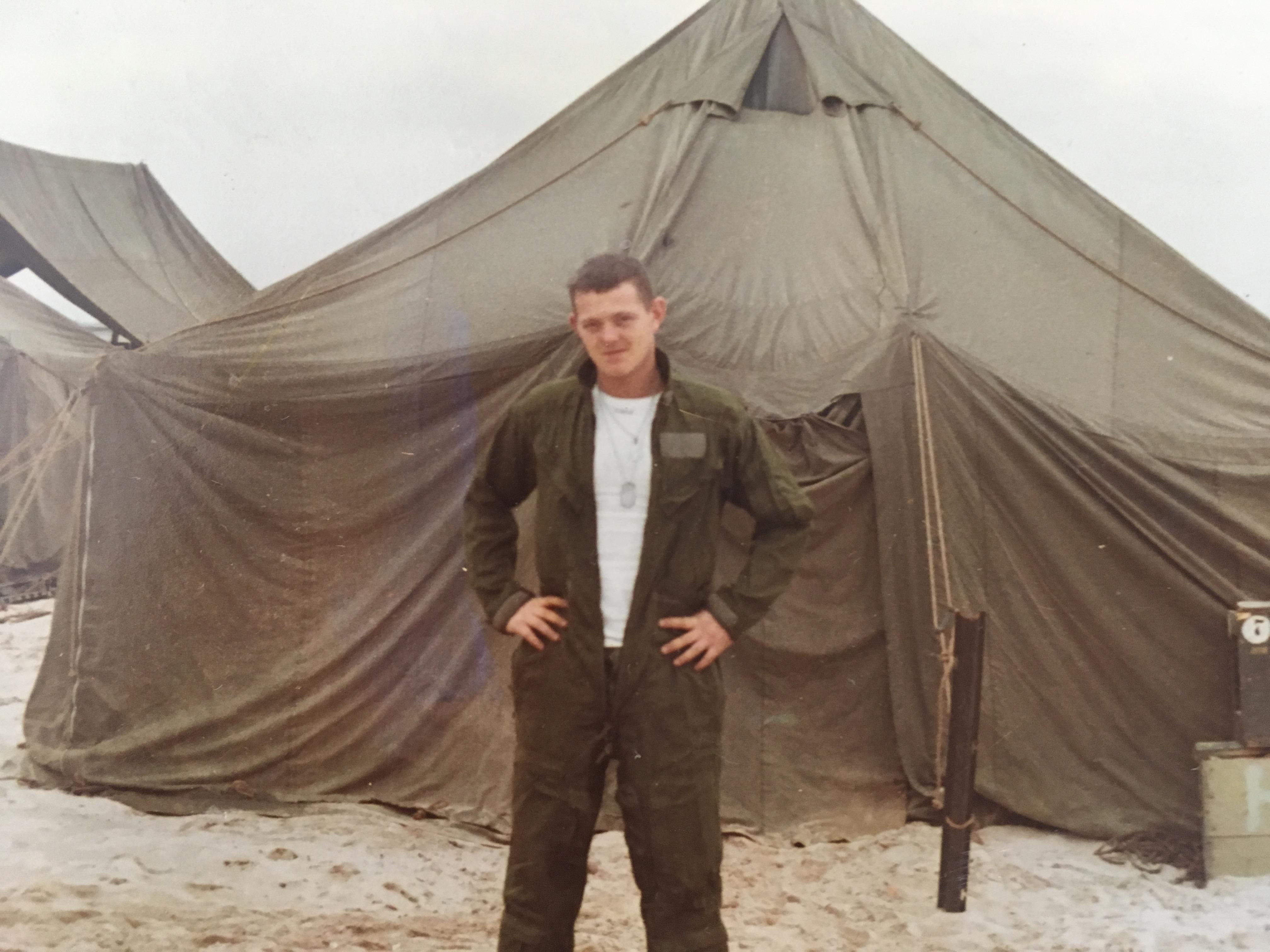 bernie in Vietnam standing in front of a tent