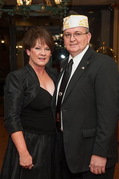 man and woman standing together in formal wear