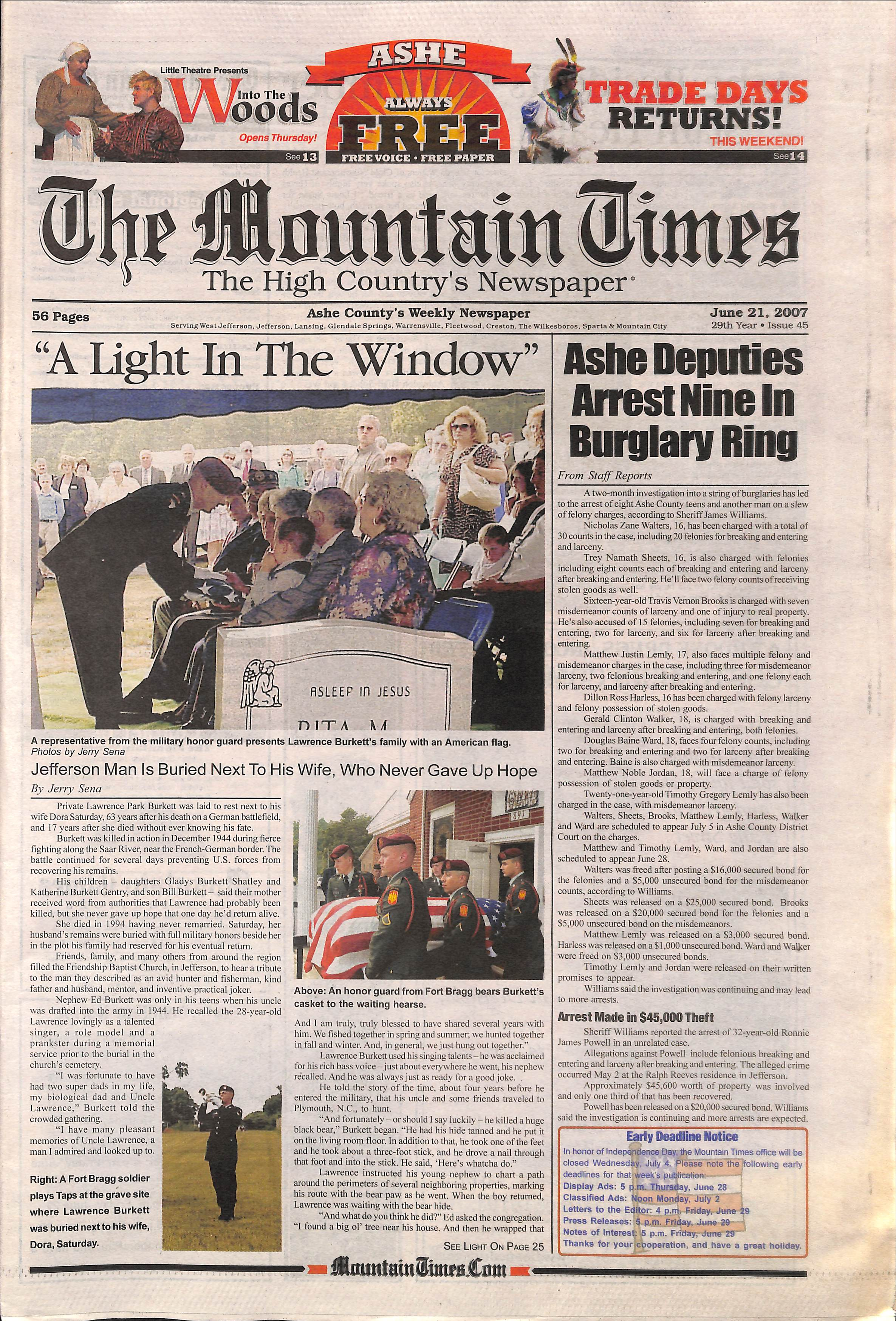 color photo of front page of Mountian Times, featuring photo of graveside service