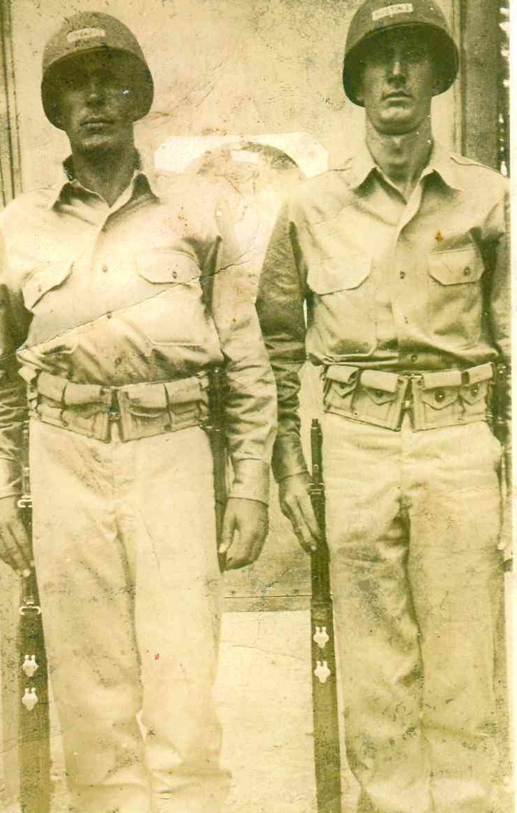 black and white photo of two soldiers standing in uniform