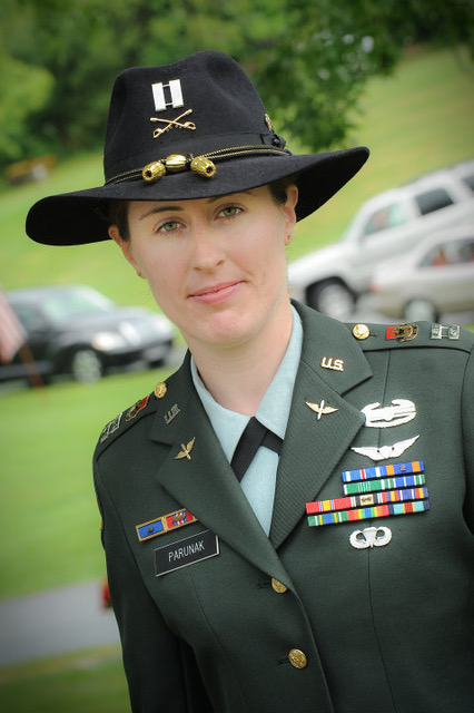 photo of woman in military dress uniform