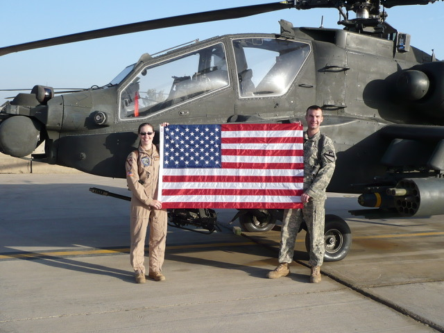 photo of man and woman holding an American flag