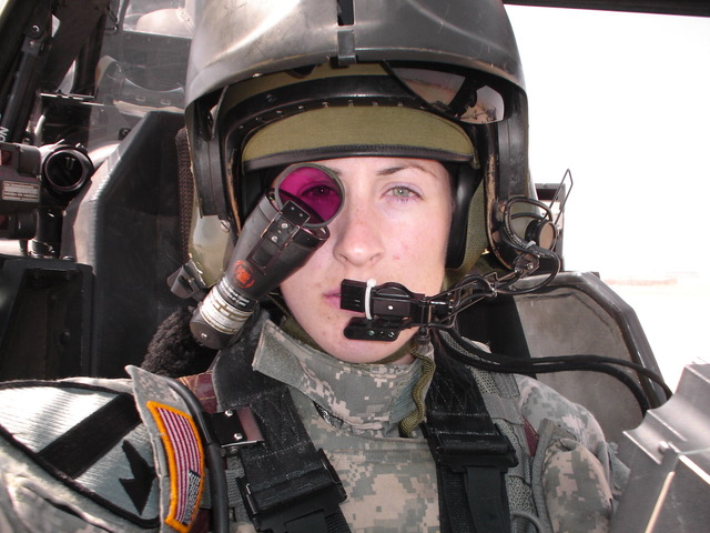 photo of woman in military fatigues with ocular lens in front of her right eye