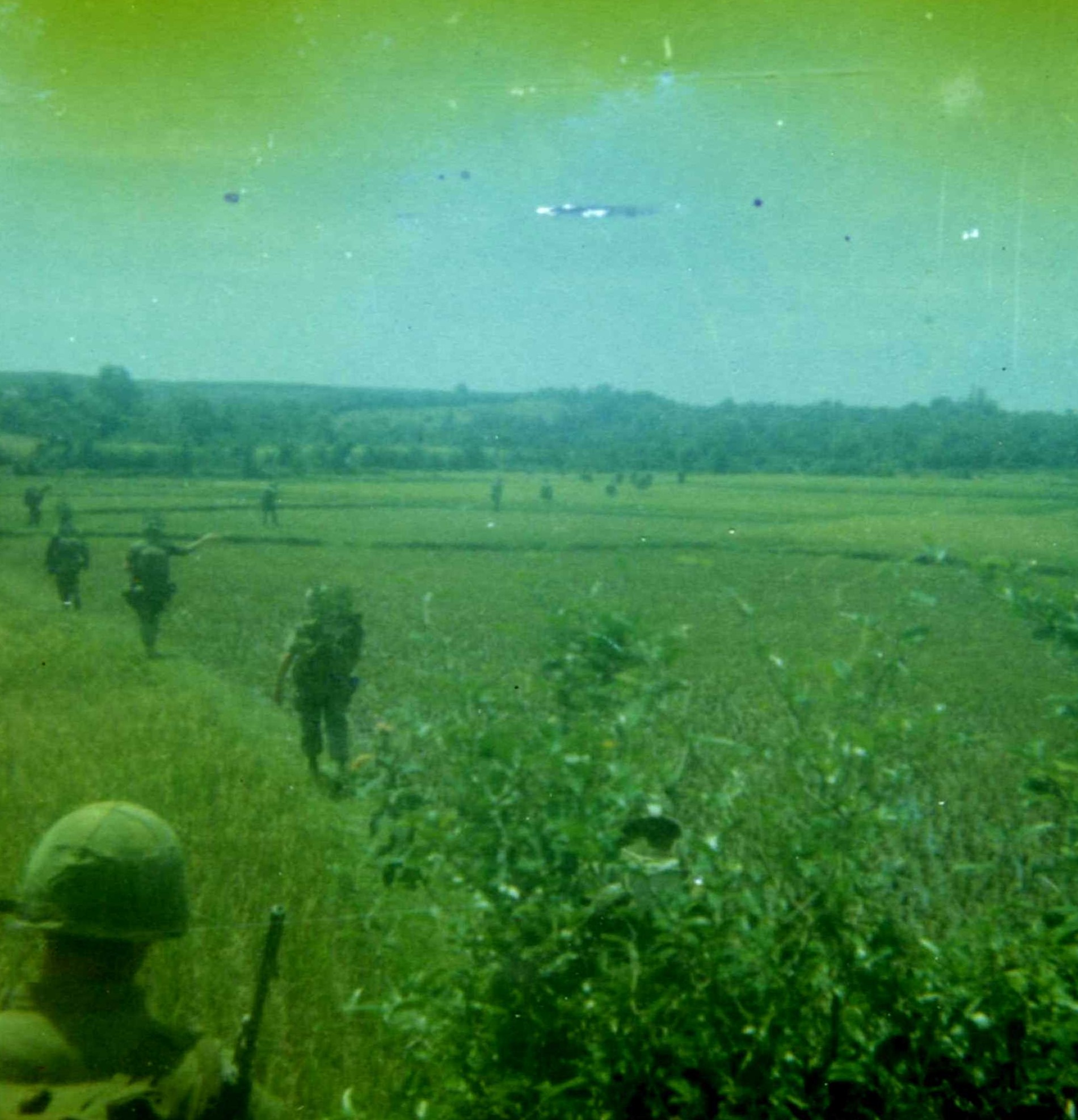marines walking across a field