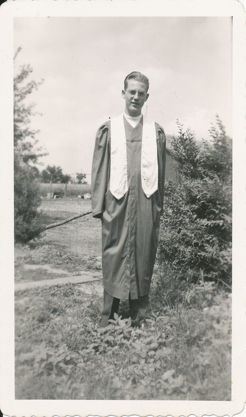 black and white photo of young man in graduation robes
