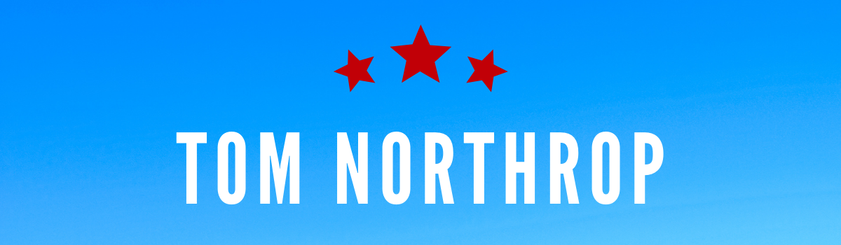 Tom Northrup's name on blue background with red stars