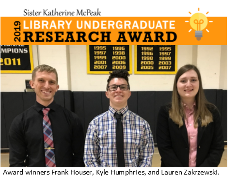 Header for the 2019 Sister Katherine McPeak Library Undergraduate Research Award. Includes a photograph of 2019 award winners Frank Houser, Kyle Humphries, and Lauren Zakrzewski.