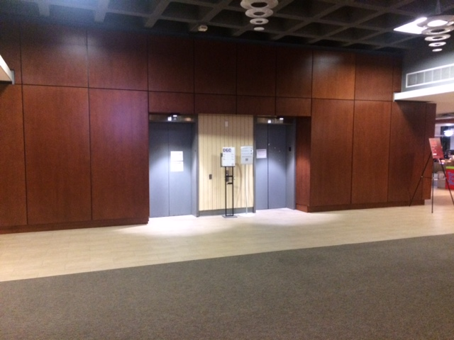 Elevators in Library North between Book Pickup & Checkout Desk & Course Reserves Desk Before Construction