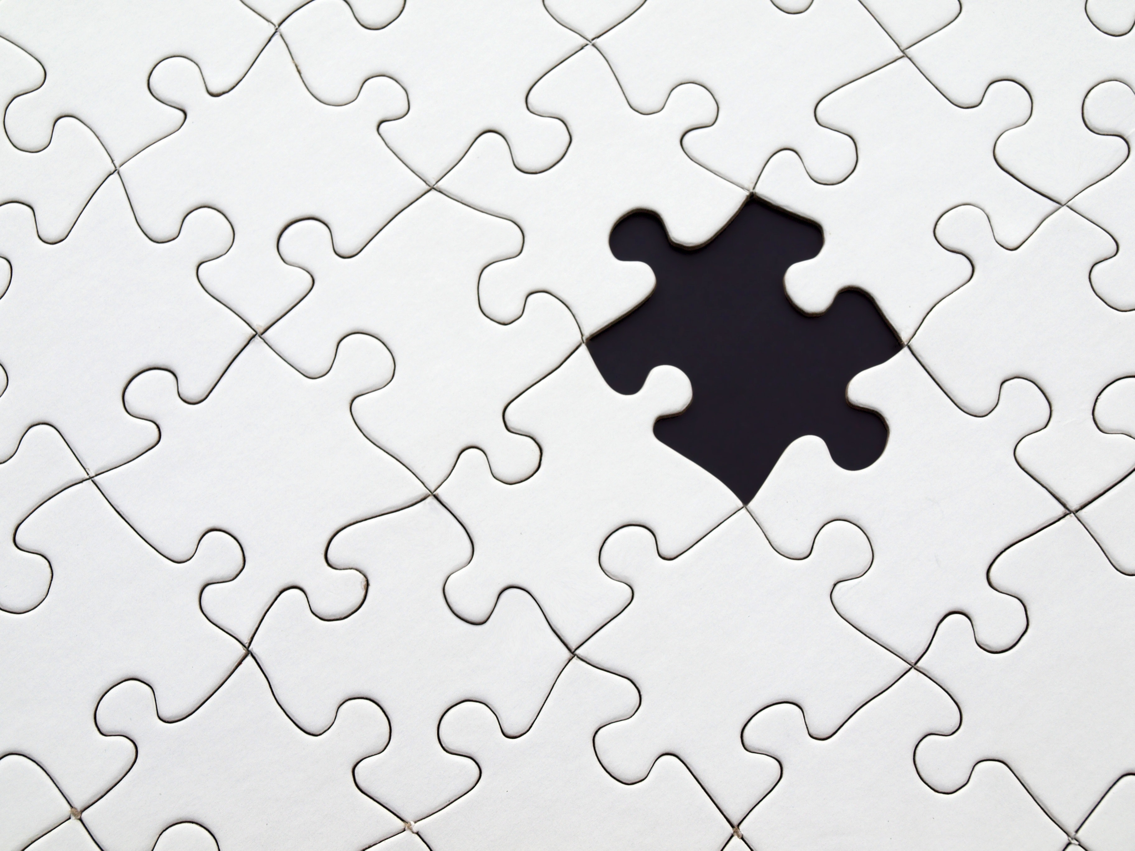 Image of puzzle with one piece missing