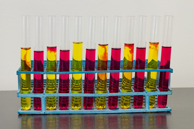 red and yellow solutions in test tubes in a rack