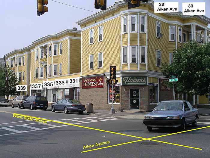 Picture of the corner of West Sixth Street and Aiken Avenue with buildings at 331-399 West Sixth Street and 28-30 Aiken Avenue