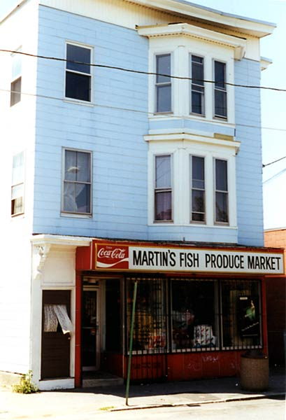 Picture of 431-433 Central Street. Sign says Martin's Fish Produce Market.