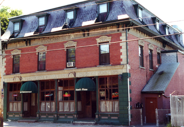 """Picture of 573 Lawrence Street with """"Greenwood Bros"""" stone carving still visible"""