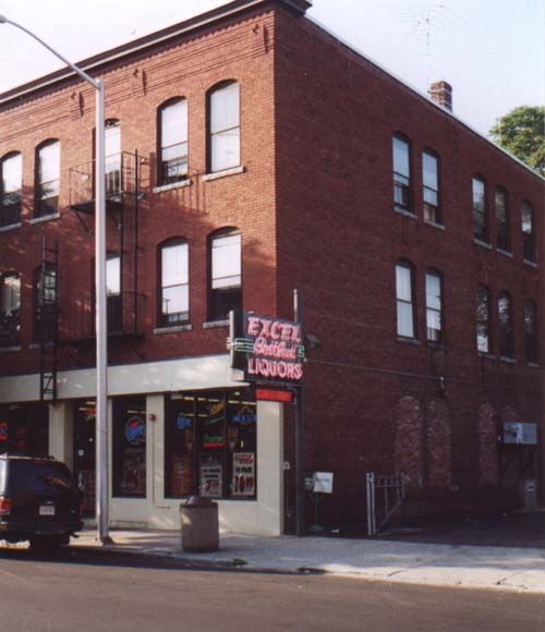 Picture of 611 Merrimack Street -- Sign say Excel Liquors