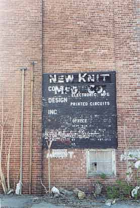 Picture of the side of 21 Nottingham Street showing New Knit Manufacturing sign, faded