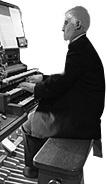 Clip art of man playing an organ