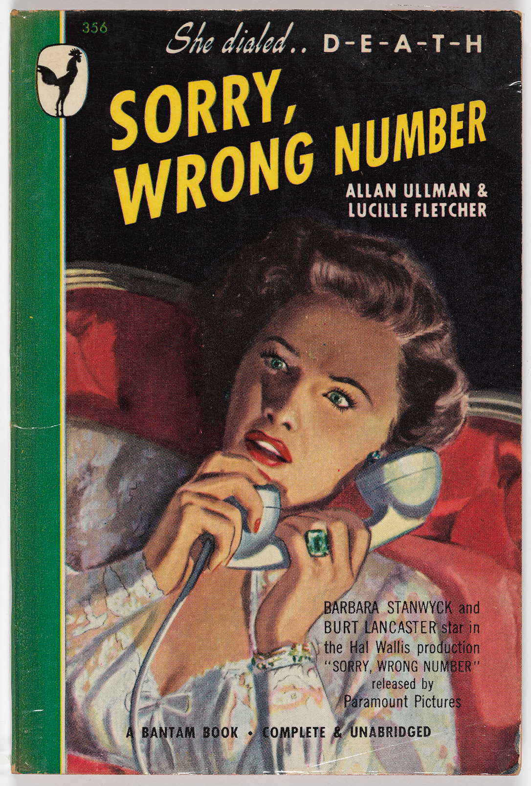"The cover for this novel by Allan Ullman and Lucille Fletcher shows a frightened brunette woman  sitting on a red velvet loveseat and clutching a phone to her ear. It is based on the Paramount Pictures film starring ""Barbara Stanwyck and Burt Lancaster."" The tagline, ""She dialed .. D-E-A-T-H"" appears at the top of the page, along with the logo for Bantam Books (a black rooster on a white backdrop)."
