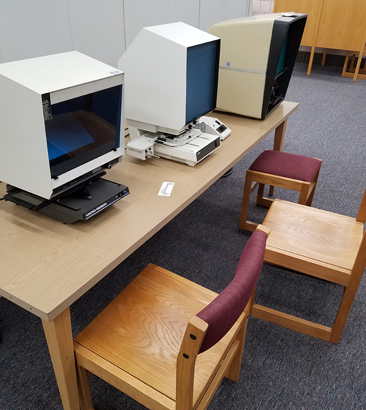 old microfilm readers near the microfilm shelves