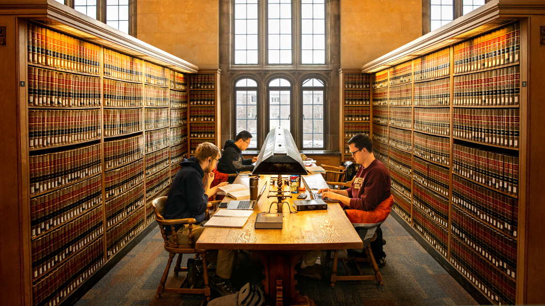Students studying at law library.