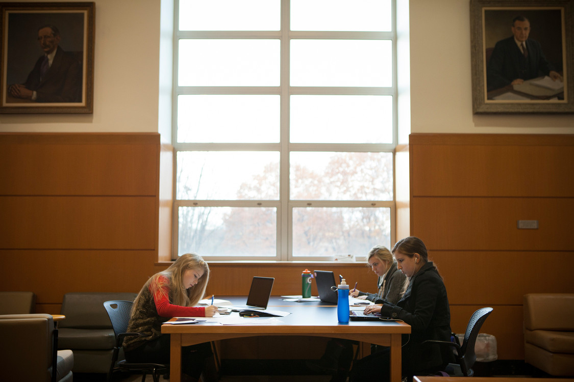 student studying at mann library