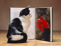 Cat reading goldfish book - Britannica ImageQuest