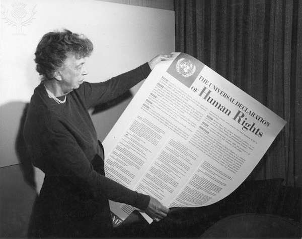 Eleanor Roosevelt holding a Universal Declaration of Human Rights poster at Lake Success, New York, November 1949 - Britannica ImageQuest