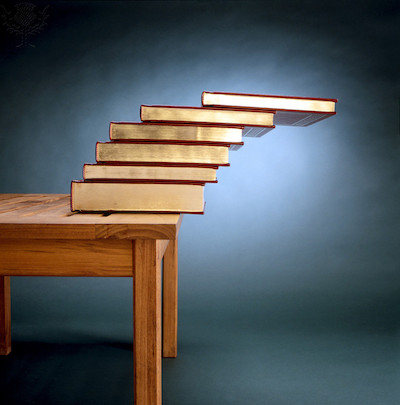 STABLE EQUILIBRIUM, STACK OF BOOKS ON TABLE EDGE Relating Center of Gravity to Area of Support - Britannica ImageQuest