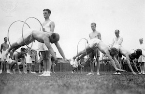 August 1935:  Teachers at a Ramsgate summer school jumping through hoops during a physical training class-Britannica ImageQuest