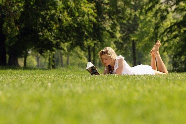 Woman reading in a park - Britannica ImageQuest