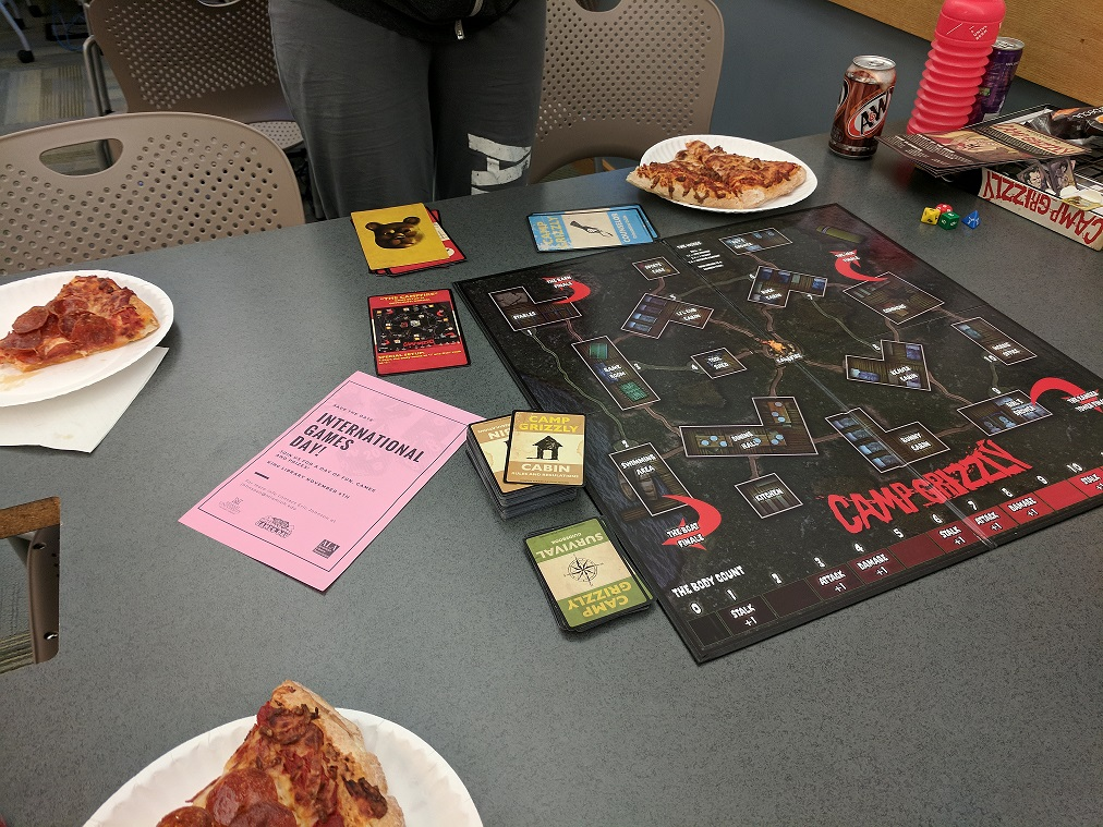 Board game with pizza