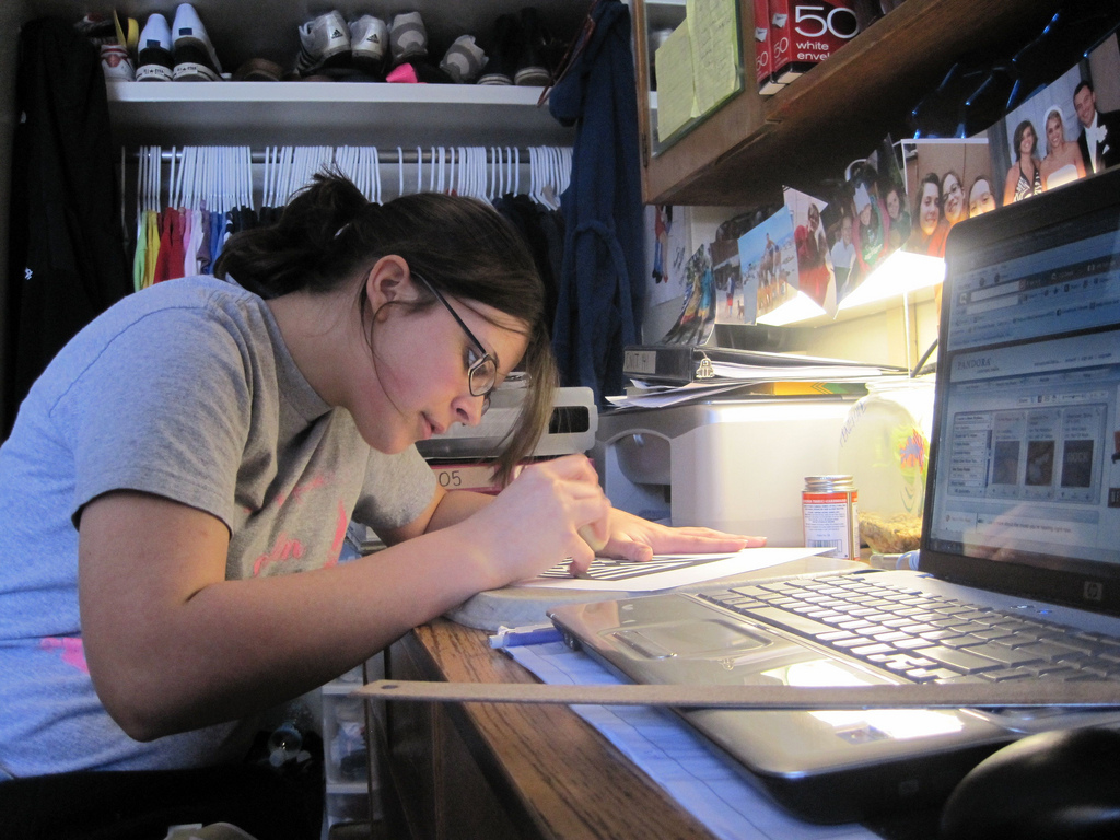 Student studying in a dorm room